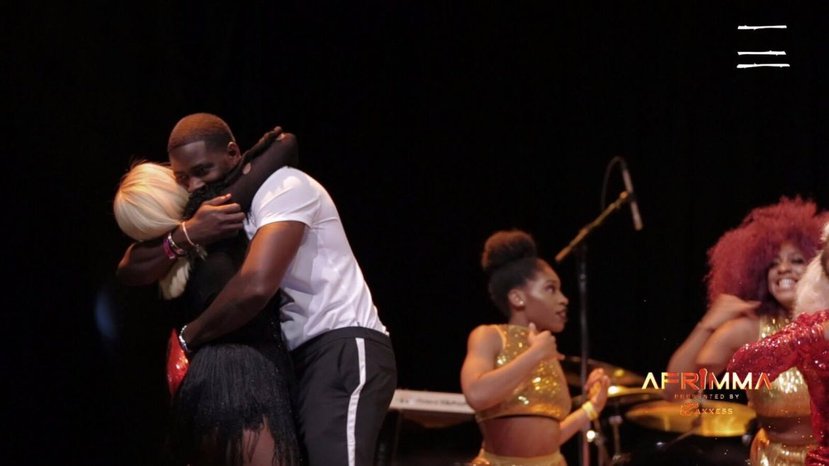 Teebillz surprises Tiwa Savage on Stage at AFRIMMA 2017